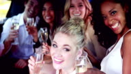 Happy friends drinking champagne in limousine video