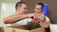 HD: Happy Gay Couple Unpacking In New Home video