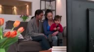 Happy Gay People Homosexual Couple Women Watching TV With Daughter video