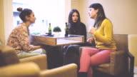 Happy girfriend's gathering in a restaurant video