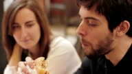 Happy girl and a guy eating burgers video