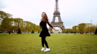 Happy girl enjoying Paris video