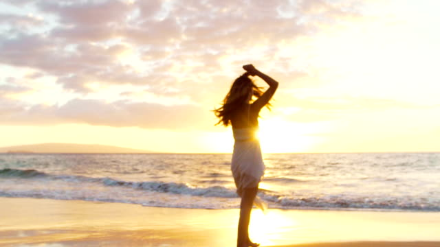 Happy Girl Having Fun at the Beach on Luxury Island at Sunset. Slow Motion video