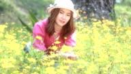 Happy girl in yellow flower field video