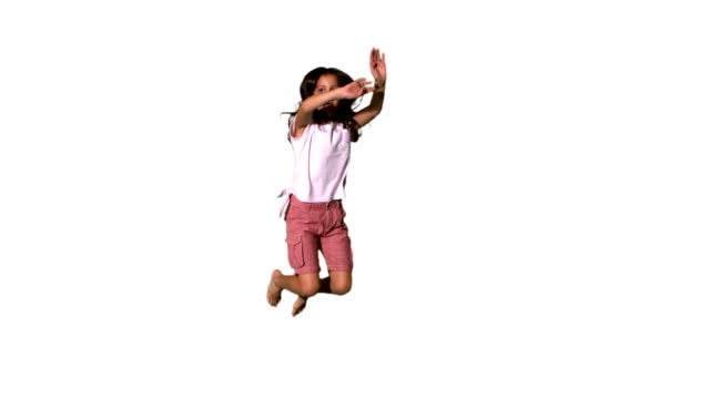 Happy girl jumping up on white background video