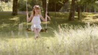 SLO MO DS Happy girl on a swing in nature video