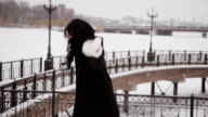 happy girl on the background of the river in winter video