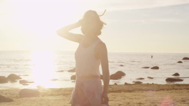Happy Girl Running, Whirling is Having Fun on the Beach in Sunlight video
