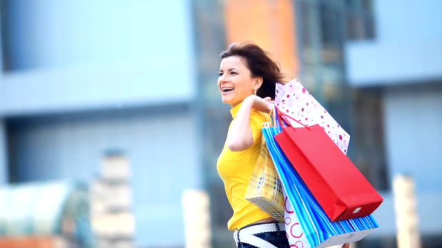 Happy girl with shopping bags. video
