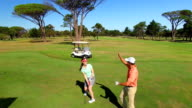 Happy golf player couple giving high five video