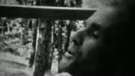 1939: Happy grandpa blowing out 72 candle birthday cake. video