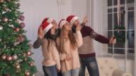 Happy group of people enjoy celebration video