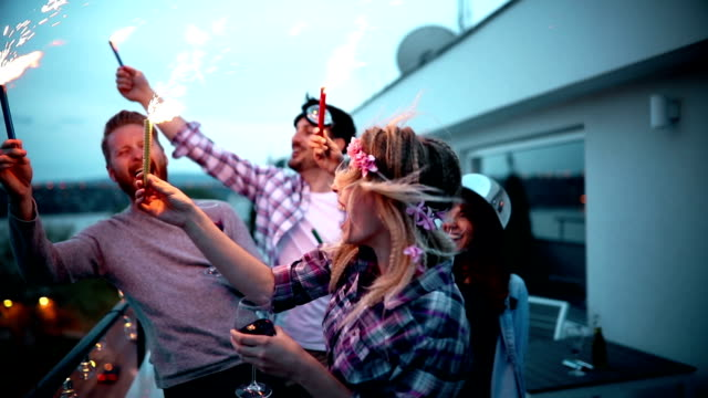 Happy group of people having fun and partying on balcony video
