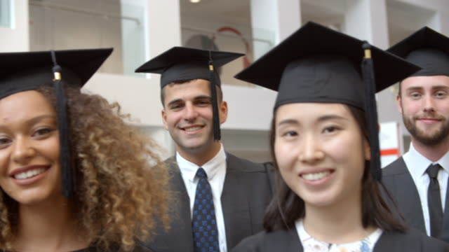 Happy group of student graduates in traditional cap and gown video