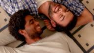 Happy homosexual couple lying on the floor video