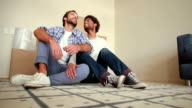 Happy homosexual couple with new house key video