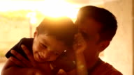 Happy Indian child playing with his father video