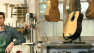 Happy Italian craftsman smiling at work video