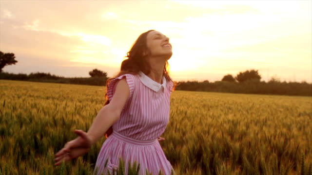 Happy Joy Laughing Beauty Woman Spinning Jumping Sunset Field video