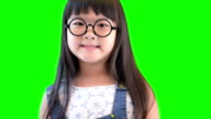 happy joyful beautiful little girl on green background video
