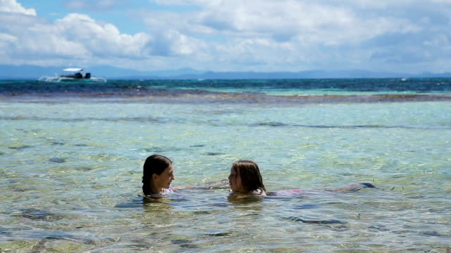 Happy kids swim in the sea video