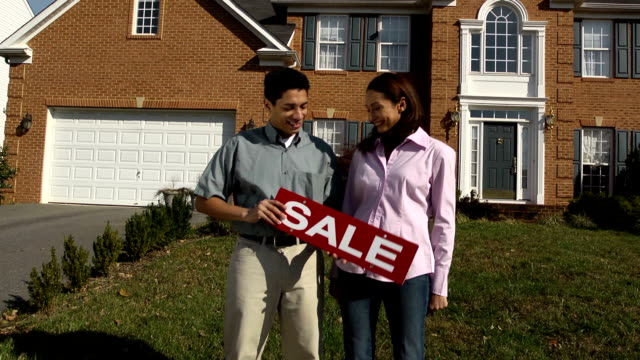 Happy Latin Couple Holding SALE Sign video
