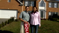 Happy Latin Couple Holding SOLD Sign video