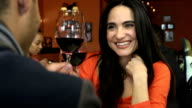 Happy Latin Woman Toasting on a Date in Restaurant video