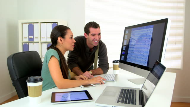 Happy Latina business woman sharing good news with colleague video