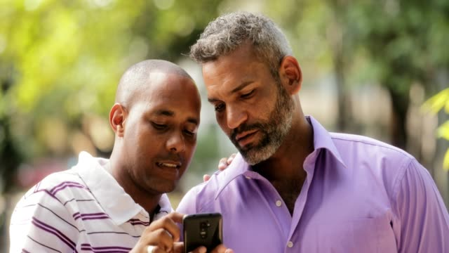 Happy Lgbt Gay Couple Looking At Pictures On Mobile Phone video