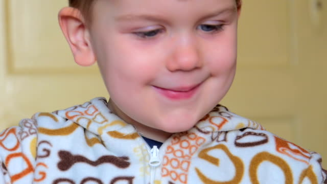Happy little boy painting. video