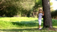 happy Little boy playing hide and seek video