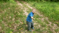Happy little boy runs with rod laughs and smiles video