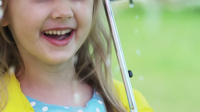 Happy Little Girl Enjoying Rain video