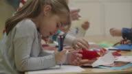 4K: Happy Little Girl in kindergarten drawing video