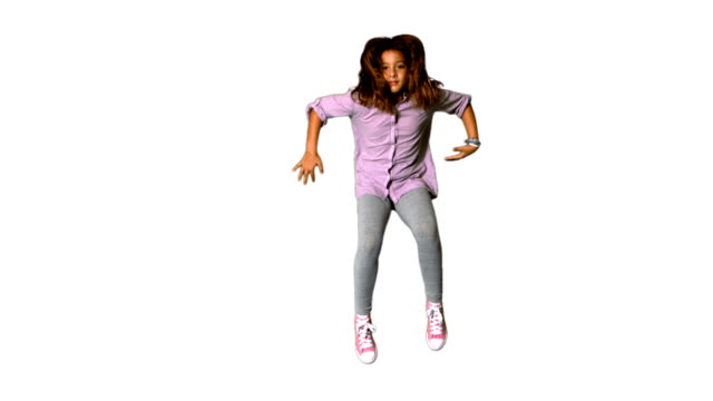 Happy little girl jumping on white background video