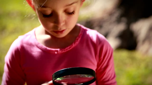 Happy little girl looking at butterfly video