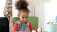 HD: Happy Little Girl Painting Easter Eggs video