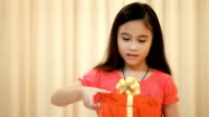 Happy little sisters opening christmas gift video