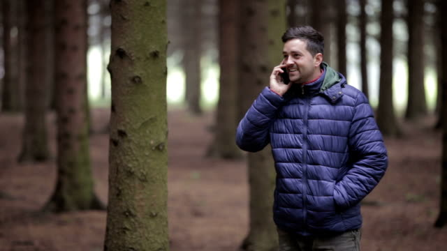 Happy man in a forest talking video