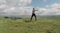 happy man on the top of the mountains to the valley video