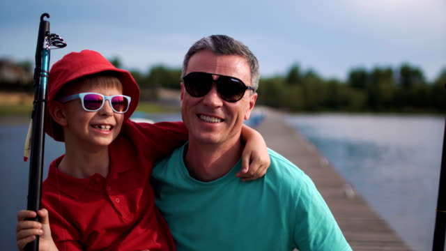 Happy man with son on pier video