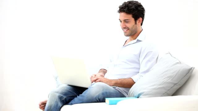 Happy man working on laptop video