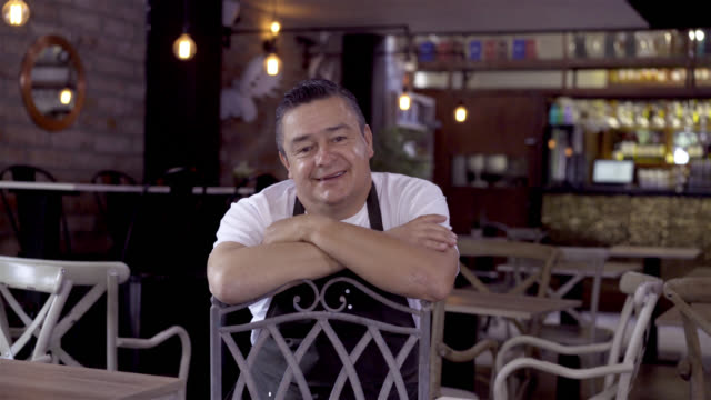 Happy manager of a restaurant looking at the camera smiling video