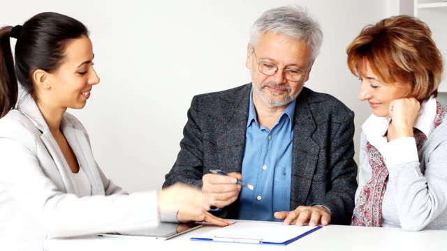Happy Mature Couple in Meeting With Financial Advisor video