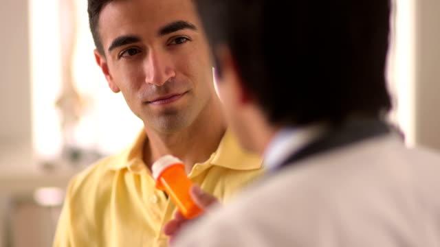 Happy Mexican patient receiving prescribed medication video
