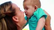 Happy mother rubbing noses with cute baby son video