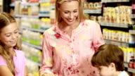 Happy mother shopping with children video
