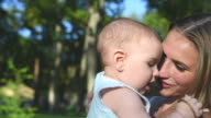 happy mother with her baby in park video