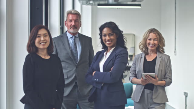 Happy multi-ethnic business group smiling video